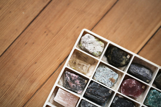 Collection of minerals in box on wooden background