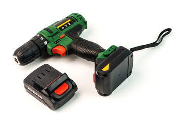 Cordless screwdriver, cordless drill and battery isolated on a white background.