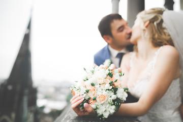 Kissing wedding couple staying over beautiful landscape