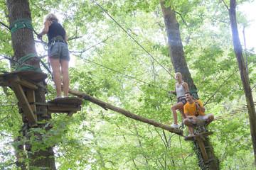 women in an adventure park wearing protective gear