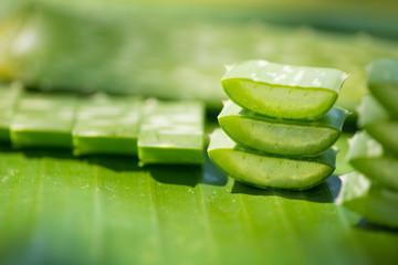 Sliced Aloe vera stack on green banana leaf