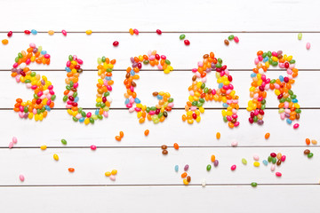 Colorful candy background with the word sugar