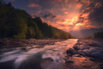 sunrise over fast mountain river