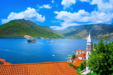 Harbor and ancient buildings in sunny day at Boka Kotor bay (Boka Kotorska), Montenegro, Europe.