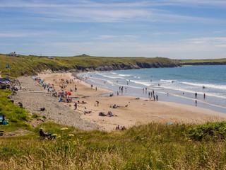 Sun worshipperes enjoying the early summer sunshiune at Whitesands Bay, St Davids Peninsular, Pembrokeshire, UK