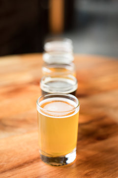 Pale ale with a flight of beer arranged in a straight row