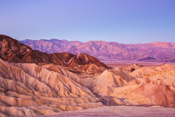 Scenic view from Zabriskie Point, showing convolutions,  color contrasts, and texture in the eroded rock at dawn, Amargosa Range, Death Valley in Death Valley National Park, United States.