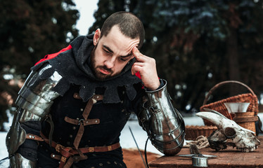 thoughtful male knight in historical clothing