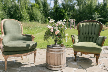 Vintage wood chairs and table with flower decoration in garden. outdoor