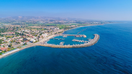 Foto op Aluminium Poort Aerial bird's eye view of Zygi fishing village port, Larnaca, Cyprus. The fish boats moored in the harbour with docked yachts and skyline of the town near Limassol city from above.