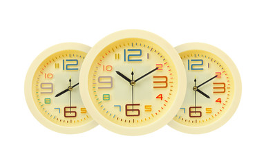 Three yellow alarm clock different time isolated