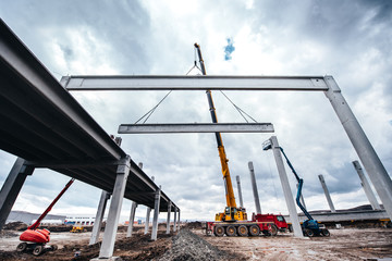 Industrial construction site with tower cranes working with prefabricated elements
