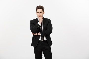 Young handsome man in black suit and glasses looking at copy-space smiling,thinking or dreaming isolated over white background