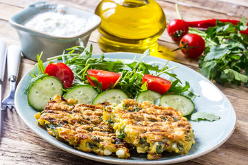 Juicy cutlets on a plate with a salad of tomatoes and arugula