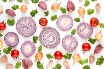 Onion and spices isolated on white background, top view. Wallpaper abstract composition of vegetables.