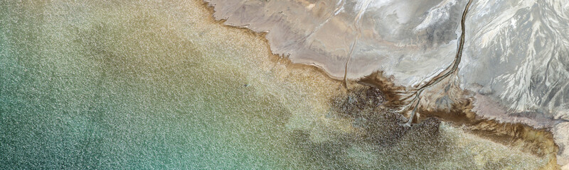 Foto op Textielframe Khaki Aerial abstract panorama of colorful water streams at Los Leones Dam, filled with water of Nevado del Plomo, and the Los Leones and Blanco rivers