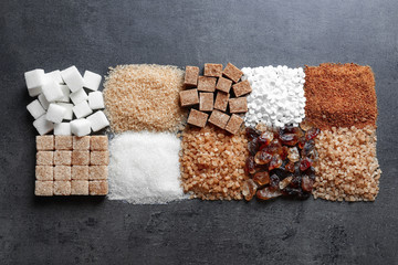 Flat lay composition with different types of sugar on gray background Wall mural