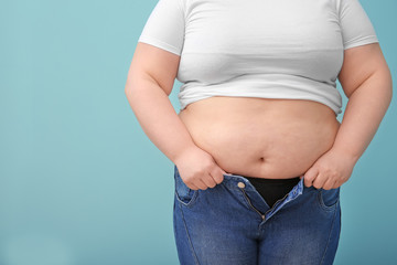 Overweight woman on color background