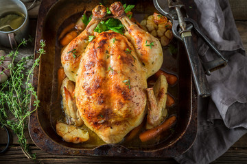 Crispy roasted golden chicken with thyme and garlic