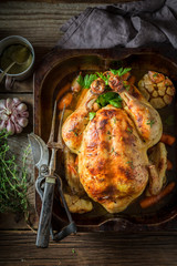 Tasty roasted chicken with hebrs and vegetables