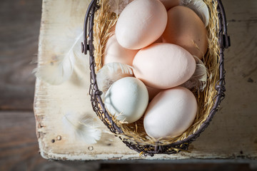 Ecological eggs from the countryside in old basket