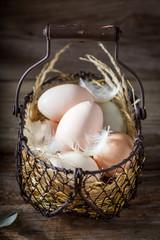 Closeup of free range eggs in old basket