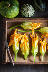 Ingredients for tasty roasted zucchini flower made of pancake batter