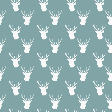 seamless winter pattern with silhouette of deer head with antlers. vector flat Christmas ornament on powder blue background