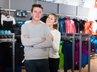 Couple choosing sports clothes