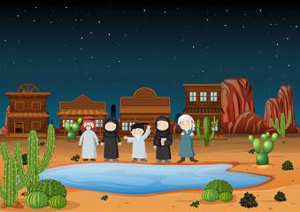 Arab people standing on desert land at night