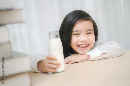 Close Up Portrait Of Adorable Little Asian Girl Drinking Glass Of Milk