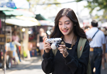 Young beautiful Asian woman smileing lifestyle with camera in city