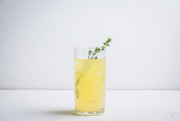 Tasty bitter cocktail with thyme. Selective focus.