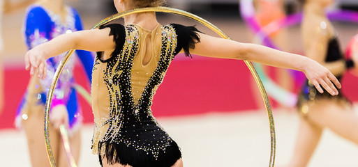 Foto op Aluminium Gymnastiek Rhythmic gymnastics competition - blurred