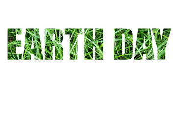 Earth Day celebration card with inscription on green grass.