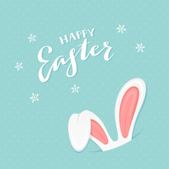 Blue background with rabbit ears and text Happy Easter