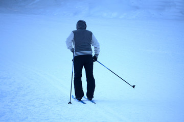 Photo of male skier in gray jacket.