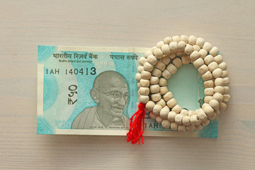A new banknote of India with a denomination of 50 rupees. Indian currency. Mahatma Gandhi and rosary, beads of Tulasi tree