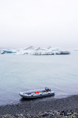 inflatable Boat at shore with icebergs