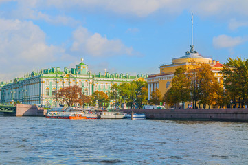 Admiralty arch and Winter Palace or State Hermitage Museum on the embankment of Neva river in St Petersburg,Russia