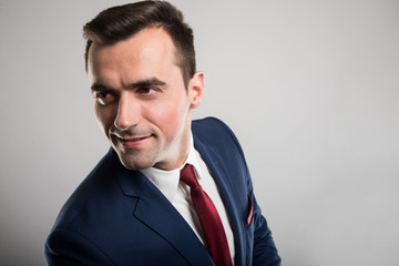 Attractive business man portrait wearing suit and smiling