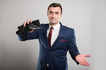 Attractive business man holding wallet upside down