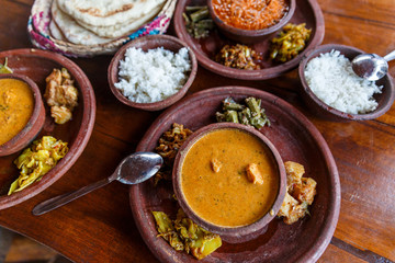 close up view of traditional asian food on wooden tabletop, sri lanka