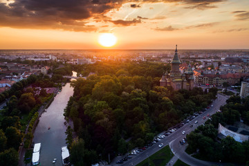 Foto op Textielframe Luchtfoto Beautiful red sunset in aerial view from Timisoara taken by a professional drone - Timișoara Orthodox Cathedral, Bega and Central Park