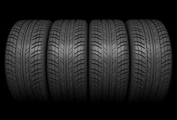 Stack of car wheel on black background