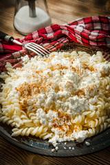 Fusilli pasta with cottage cheese, sugar and cinnamon.