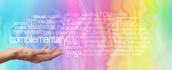 Complementary Therapy Word Tag Cloud - female hand held palm up the word COMPLEMENTARY in white above surrounded by a relevant word cloud on a rainbow colored marble effect background