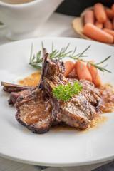 lamb steak on white plate