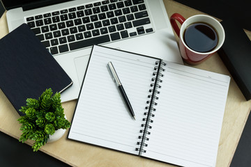 Laptop, Pen, Diary and Notebook on Wood Background