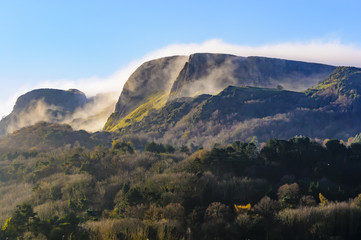 """Mist/low clouds roll over """"Napoleon's Nose"""", Cave Hill, Belfast in late autumn sunshine"""